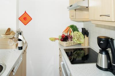 Kitchen with dish washer coffee machin etc.